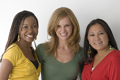 Three women smiling. Clare of Assisi House provides halfway house living in Berks County PA, ex-offender halfway house, halfway housing for ex-offenders, halfway house for ex offenders, halfway house for ex convicts, halfway house for ex prisoners, halfway house for drug addicts, and halfway house for women. They provide transitional housing for non-violent women who are being released from jail.