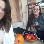 Clare of Assisi House ladies handing out candy on Halloween